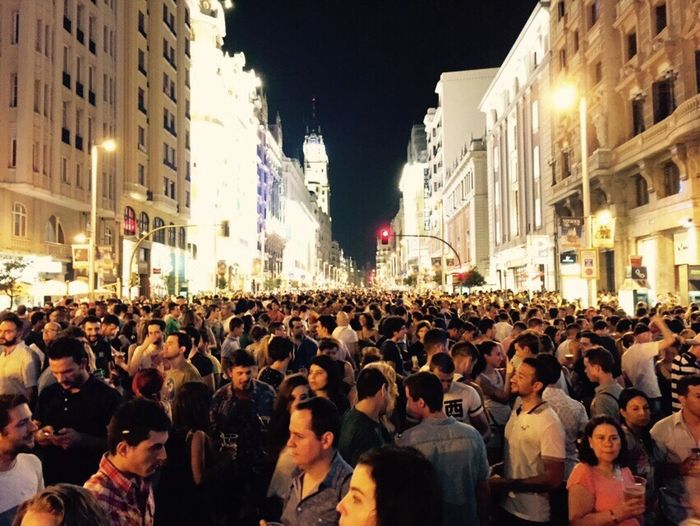 Gran Vía Large Group Of People Crowd City Building Exterior Street Architecture Night Built Structure City Life Togetherness Illuminated City Street Men Standing Road Person Crowded Rush Hour Busy Protest