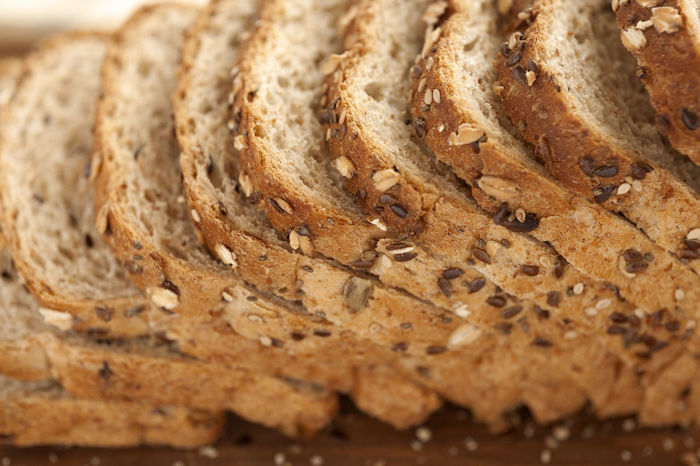 Sliced multigrain bread on cutting board. Lateral View. Closeup. Breakfast Diet Natural Wheat Bake Bakery Bread Brown Bread Close-up Crust Directly Above Food Food And Drink Grain Healthy Eating Loaf Loaf Of Bread Multigrainbread No People Sliced Sliced Bread Studio Photography Wholemeal Bread