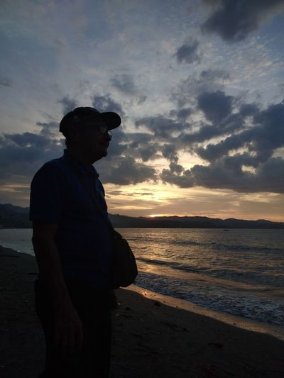 Amahan No Edit/no Filter Eyeem Philippines Eyeem Market Eyeemphotography PhonePhotography Dramatic Sky Old Man Water Sea Sunset Beach Silhouette Standing Full Length Reflection Sky Shore Calm Scenics Horizon Over Water Tranquil Scene Tranquility Countryside
