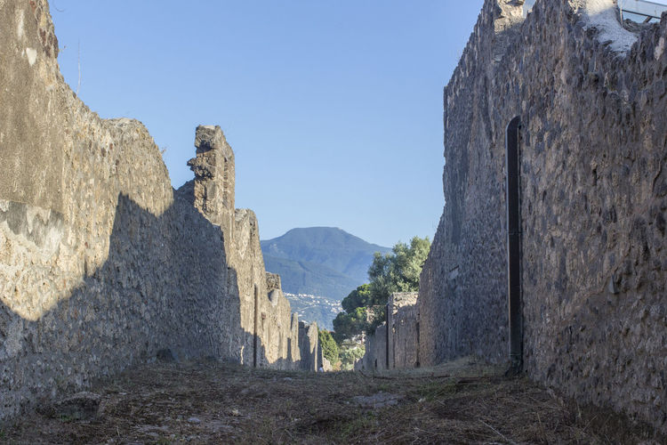 Panoramic view of old ruins against clear sky