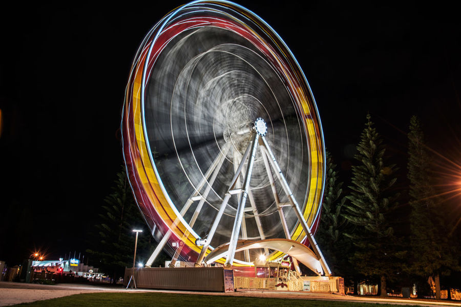 Still going around must be witchcraft Arts Culture And Entertainment Amusement Park Ferris Wheel Night Amusement Park Ride Illuminated Circle Turning Long Exposure Leisure Activity Park - Man Made Space Nightlife Low Angle View Motion Taking Photos Enjoying Life Relaxing