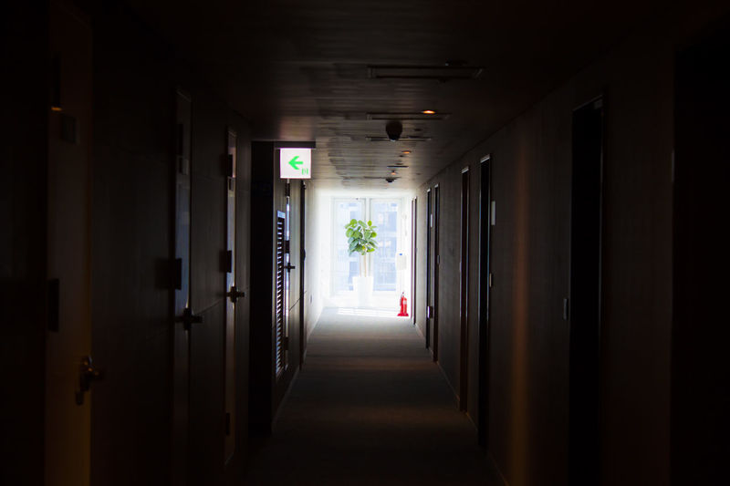 Direction Corridor The Way Forward Architecture Indoors  Building Door Diminishing Perspective Absence Narrow Dark Flooring Ceiling Light At The End Of The Tunnel Light Fixture Day No People
