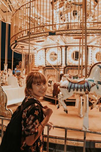 Woman standing in amusement park