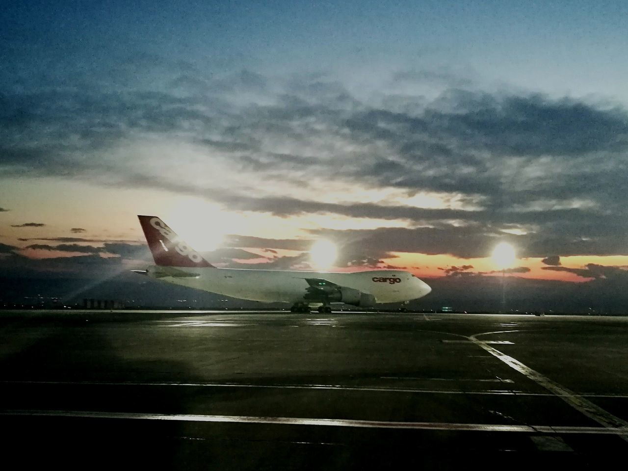 airplane, transportation, sky, sunset, air vehicle, cloud - sky, sun, airport, airport runway, mode of transport, no people, outdoors, nature, runway, flying, day, commercial airplane, airplane wing