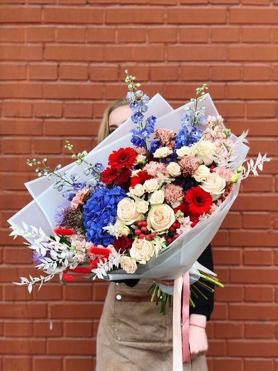 Flower pot against brick wall