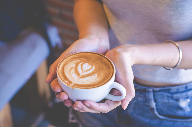 Cafe Cappuccino Coffee Coffee - Drink Coffee Cup Cup Drink Food And Drink Froth Art Frothy Drink Hand Holding Hot Drink Human Body Part Human Hand Latte Lifestyles Mug People Positive Emotion Real People Refreshment