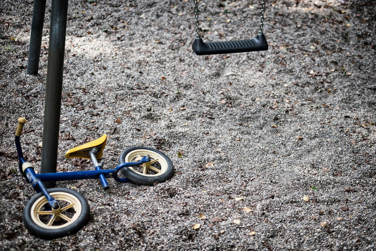 High angle view of toy bicycle parked
