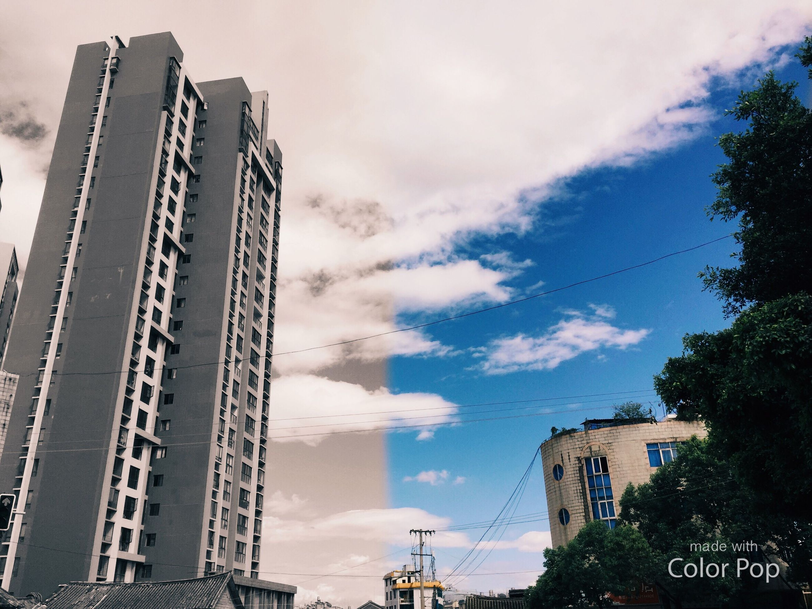 architecture, sky, built structure, cloud - sky, building exterior, low angle view, day, outdoors, tree, no people, city
