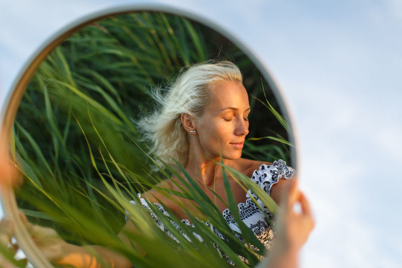 Close-up of woman reflecting on mirror