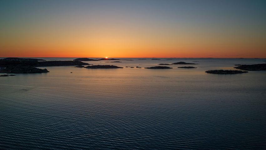 Sunset in the summer. Bohuslän, Sweden. Sea Water Sky Sunset Beauty In Nature Tranquility Horizon Over Water Horizon Idyllic Nature Orange Color Waterfront No People Outdoors Coast Coastscape Bohuslän Nordic Nordic Light Colours Future Evening Twilight Summer