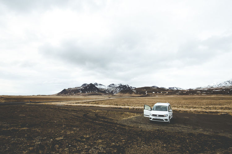 Days of travel: 4 - Western Region, Snæfellsnes Peninsula Iceland Travel Beauty In Nature Car Cloud - Sky Day Environment Field Land Vehicle Landscape Mode Of Transportation Motor Vehicle Mountain Nature No People Non-urban Scene Road Trip Roadtrip Scenics - Nature Sky Snowcapped Mountain Tranquil Scene Tranquility Transportation Traveler The Traveler - 2018 EyeEm Awards The Great Outdoors - 2018 EyeEm Awards Summer Road Tripping My Best Travel Photo