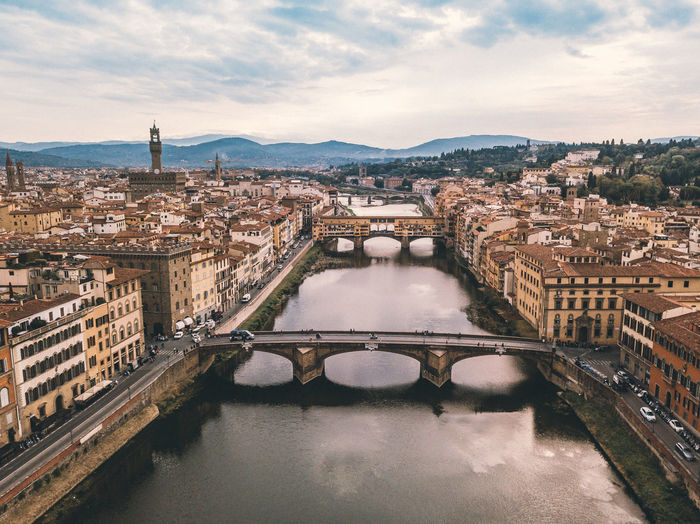 Ponte Vecchio in Florence Architecture Built Structure Building Exterior Water City Sky Connection Cloud - Sky Cityscape Bridge Nature River Bridge - Man Made Structure Building High Angle View Residential District Day No People Travel Destinations Outdoors Arch Bridge Ponte Vecchio - Firenze Firenze Florence