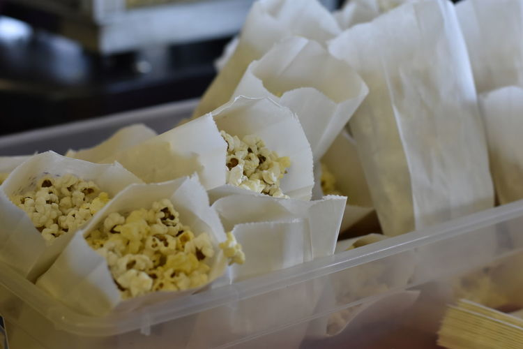 Close-up of popcorn in paper bags for sale in store
