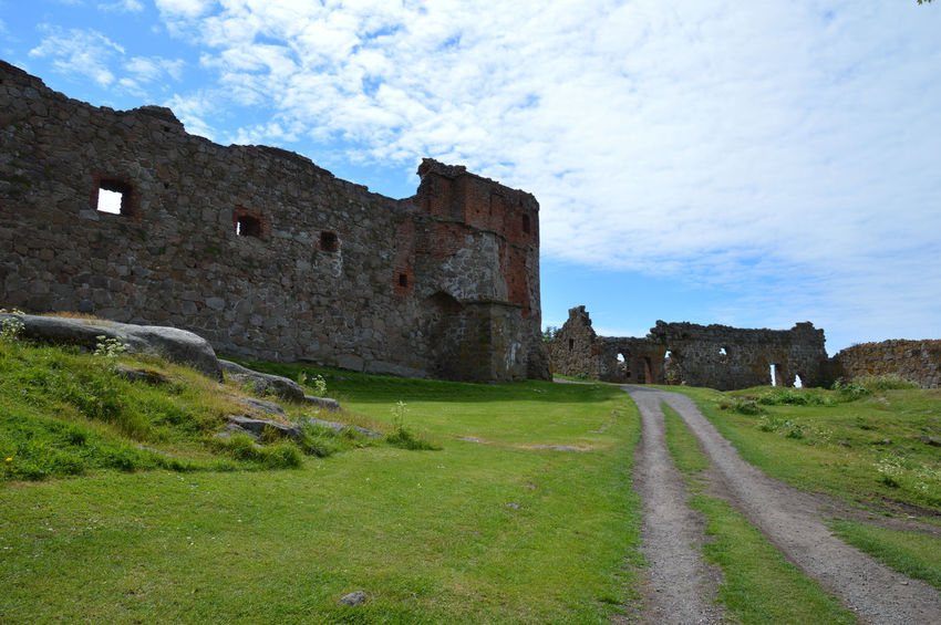 Denmark Ancient Architecture Building Building Exterior Built Structure Castle Day Direction Fort Grass Hammershus Scandinaviancastle Ruins Bornholm Denmark History Nature No People Old Outdoors Plant Road Ruined Sky Stone Wall The Past The Way Forward Transportation
