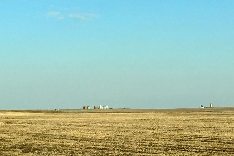Vast Field Ploughing Sky And Clouds Buildings Business Finance And Industry Beauty No People Day Dried Plants Agriculture Prairie