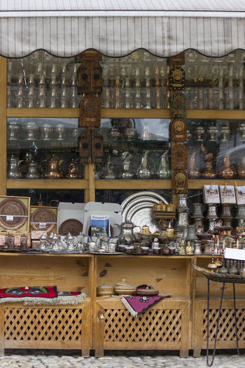Souvenir shop in Sarajevo Antique Bazaar Bosnia And Herzegovina Copper Art Crafts Market Objects Ottoman Bascarsija Copper  Gifts Market Stall Nobody Object Outdoors Retail  Sarajevo Souvenir Stall Turkish