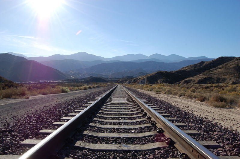Looking east down track towards the San Gabriel Mountains from Cajon Pass. Beauty In Nature Cajon Pass Clear Sky Day Landscape Mountain Mountain Range Nature No People Outdoors Rail Transportation Railroad Track Scenics Sky Sunlight The Way Forward Transportation