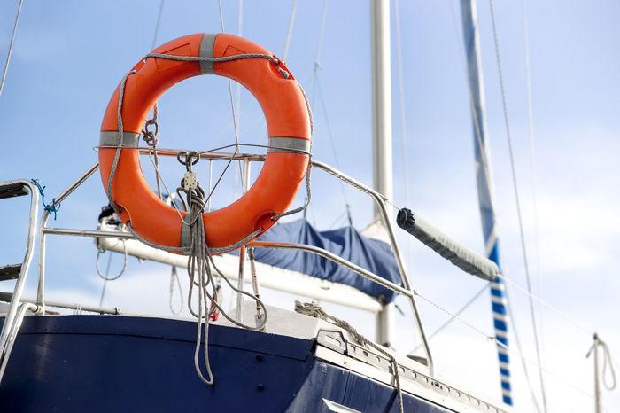 sailboat and lifebuoy , selective focus Boating Travel Cruise Day Lifebuoy Luxury Nautical Vessel No People Sailboat Sailboats Sailer Sailing Sea Season  Sky Tourism Tropical Water Yacht