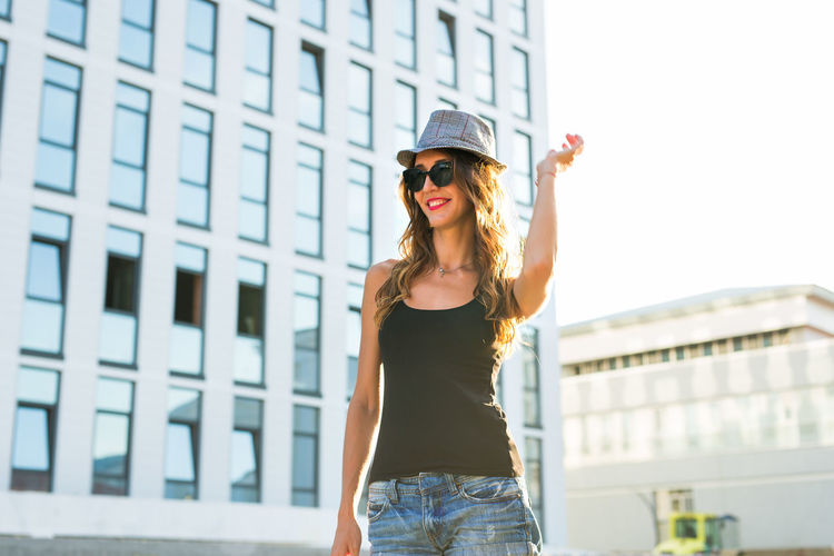 Woman wearing hat while standing outdoors