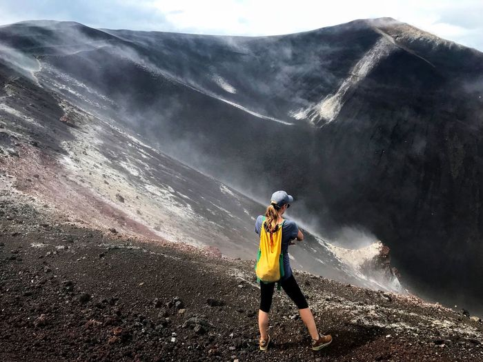 Adventure Nature Backpack Challenge Landscape Volcanic Crater Foggy Morning Extreme Sports Exploration Adrenaline Junkie Cerro Negro Nicaragua Volcanic Landscape Volcanic Rock Lava Field Determination Women Crater Hiking Smoke - Physical Structure Power In Nature Standing Scenics Energetic Volcano Crater