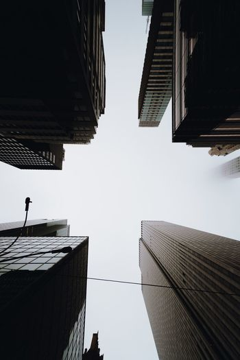 Architecture Built Structure Building Exterior Sky Building Low Angle View Clear Sky Nature Day Tall - High Office Building Exterior No People Skyscraper City Directly Below Outdoors Office Tower Roof Residential District