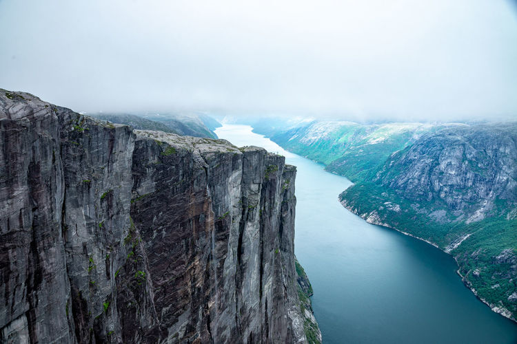 Fjord Water Scenics - Nature Beauty In Nature Mountain Rock Tranquil Scene Cliff Tranquility Rock Formation Nature No People Sea Day Sky Rock - Object Solid Outdoors High Angle View Idyllic Formation Eroded Norway