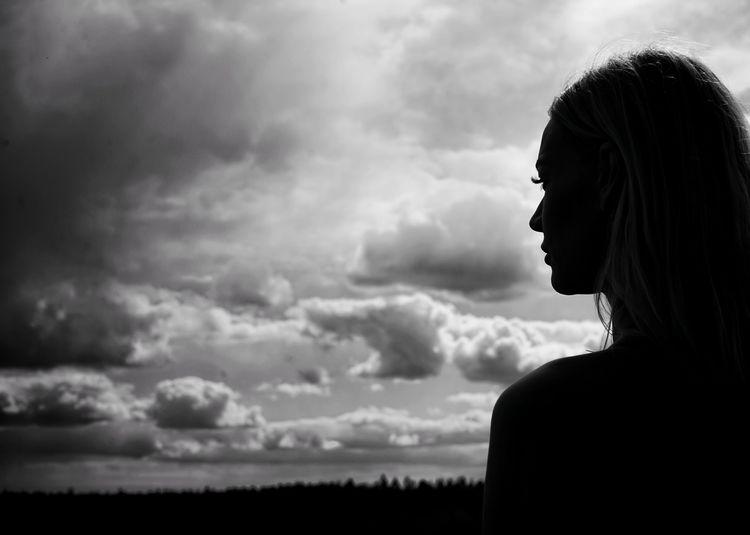 Portrait of silhouette woman against sky