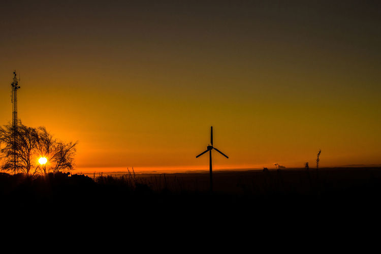 Modern Derbyshire Sunrise Alternative Energy Beauty In Nature Environmental Conservation Fuel And Power Generation Landscape_Collection Landscape_photography No People Outdoors Phone Masts Renewable Energy Scenics Silhouette Sky Sunrise Silhouette Sunrise_sunsets_aroundworld Wind Power Wind Turbine Wind Turbine Wintertime
