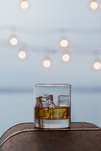 Color deck lights over whiskey on the rocks Alcohol Bourbon Close-up Cocktail Day Drink Drinking Drinking Glass Heat - Temperature HERO Ice Illuminated Indoors  Nature No People Rocks Scotch Selective Focus Water Whiskey