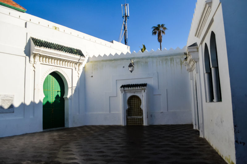 Low angle view of entrance of building against clear sky