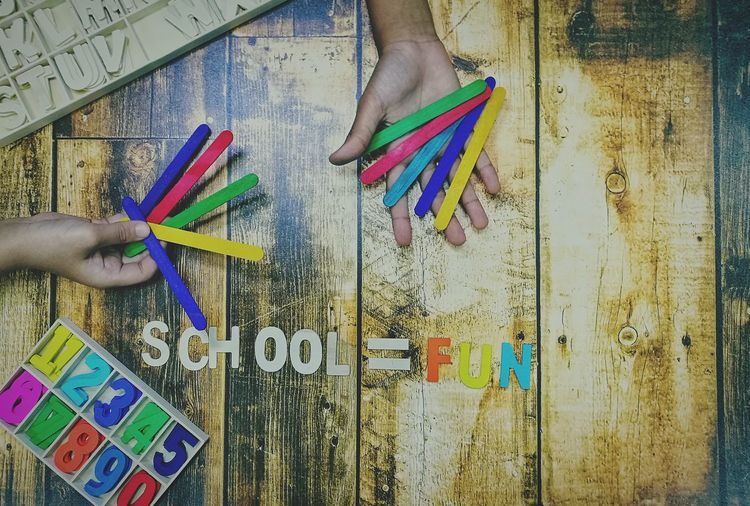 Education Fun Enjoying Life Childhood Children Kids Boys Girl Playing Asian  Multi Colored Human Hand Human Body Part Art And Craft Text Real People Day Holding Close-up People Indoors