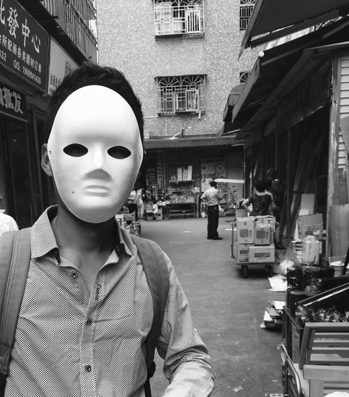 Chinese Man wearing Mask at Dafen Oil Painting Village - Shenzhen, China Artistic Chinese Man Dafen Oil Painting Village Man Dafen Art Store Masks Dafen Chinese Black And White Oil Painting Chinese Street Street Photography On The Street Adult Black And White Photography Face Masks Face Mask Masked Mask Arts