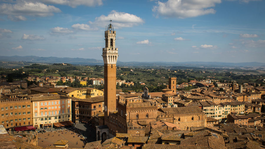 Siena main town square and city hall Architecture Building Building Exterior Built Structure City Cityscape Cloud - Sky Crowd Crowded Day High Angle View History Nature Outdoors Place Of Worship Religion Residential District Sky Tower TOWNSCAPE Travel Travel Destinations