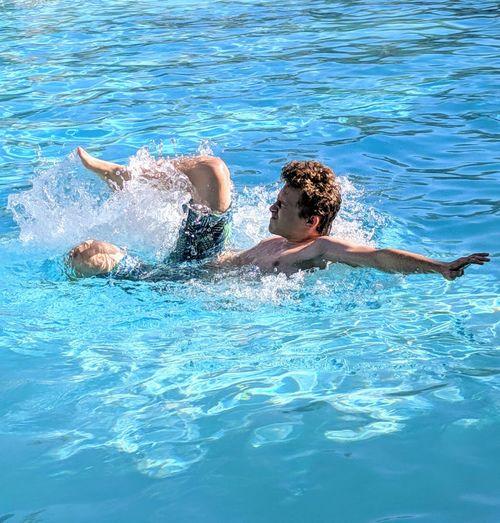 Teenage boy having fun swimming in pool