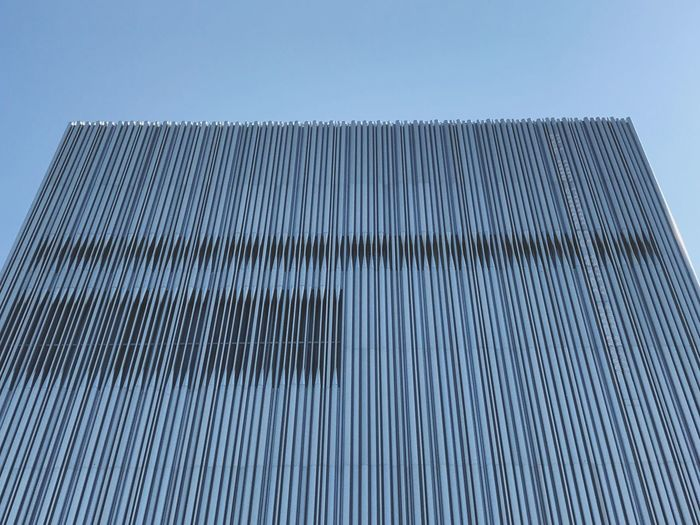 Lines. Lines Sky Low Angle View Pattern No People Clear Sky Built Structure Architecture Day Building Exterior Modern Building Blue Metal Outdoors City Tall - High Office Building Exterior Repetition