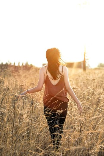 There is a place. Young Women Rural Scene Women Females Sunset Summer Motion Youth Culture Happiness Carefree Ear Of Wheat Farmland Wheat Cultivated Land Crop  Corn - Crop Plantation Farm #FREIHEITBERLIN