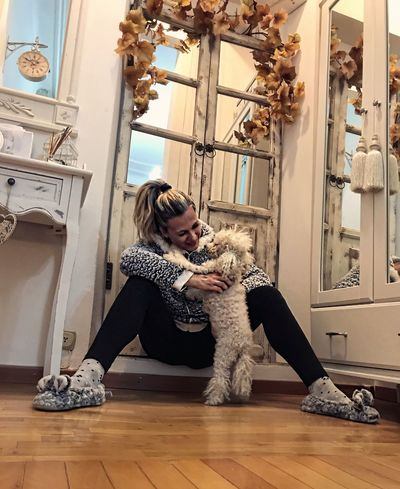 Connection Confidence  Loyalty Playing Bonding Togetherness Poodletoy Poodle Pet Pets Indoors  Dog Owner Lifestyles One Animal Sitting Love One Person Home Interior Young Adult Mammal Animal Themes Blond Hair People