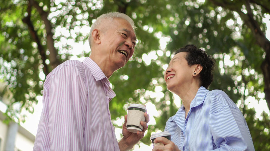 Man and woman drinking glass outdoors