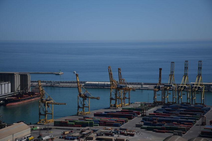 Barcelona's cargo port Cranes Commercial Dock Crane Freight Transportation Harbor Horizon Over Water Industry Mode Of Transportation Moored Nautical Vessel Sea Shipping  Shipyard Transportation Water