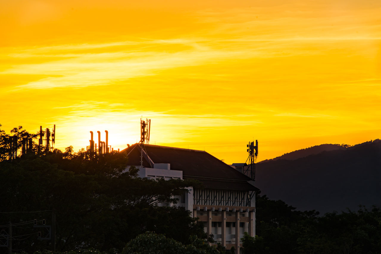 sunset, built structure, architecture, orange color, building exterior, sky, tree, no people, silhouette, nature, outdoors, beauty in nature, day