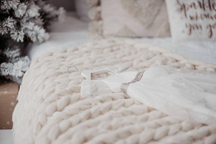 Close-up of blanket on bed at home