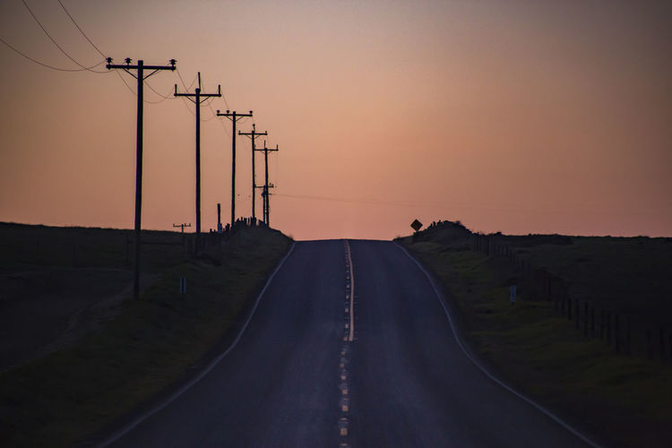Beauty In Nature Cable Clear Sky Connection Day Diminishing Perspective Electricity  Electricity Pylon Landscape Mountain Nature No People Outdoors Road Scenics Silhouette Sky Sunset Telephone Line The Way Forward Tranquil Scene Transportation