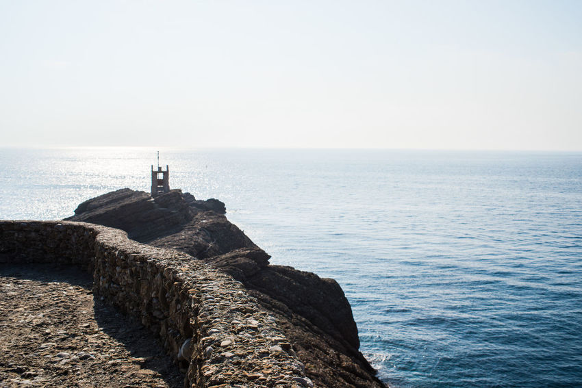 Hiking Rock Formation Travel Adventure Battery Cape  Defences Fortification Horizon Over Water Liguria Punta Chiappa Rock - Object Sea Sky Stone Tourism Tranquil Scene Water