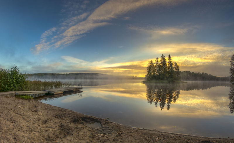 Beauty In Nature Cloud - Sky Countryside Lake Majestic Moody Sky Nature No People Non-urban Scene Outdoors Physical Geography Reflection Riverbank Scenics Sky Standing Water Sunset Tourism Tranquil Scene Tranquility Travel Destinations Tree Water