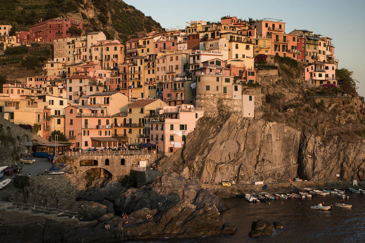 Architecture Building Building Exterior Built Structure Canal Cinque Terre Liguria City City Life Day Italy Manarola Outdoors Residential Building Residential District Residential Structure Sky Tourism Town TOWNSCAPE Travel Destinations Water Colour Of Life
