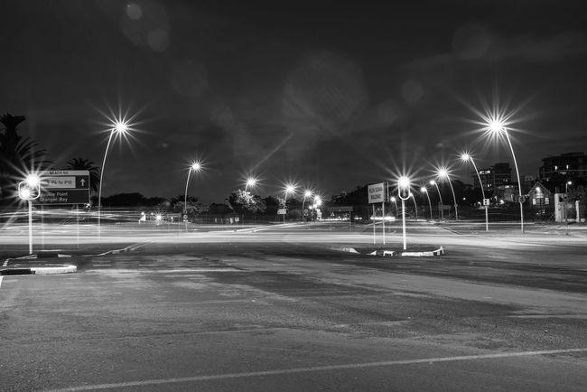 Architecture Car City Empty Illuminated Light Light Beam Light Trail Lighting Equipment Long Exposure Motion Motor Vehicle Nature Night No People Outdoors Road Sky Street Street Light Transportation