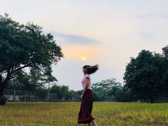 Life in mono Plant Sky Tree Nature Field Growth Land Cloud - Sky Real People Grass Sculpture One Person Standing Women Outdoors Day Side View Representation Lifestyles