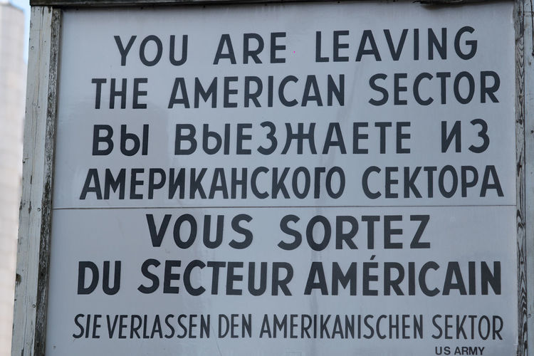 You are leaving the American sector. Sign placed by the Checkpoint Charlie in Berlin in English, Russian, French and German Berlin Wall Checkpoint Charlie  European History Memorial Berlin Wall Memorial Check Point Charlie Checkpoint Charlie Berlin  Checkpointcharlie Cold War East Berlin History West Berlin