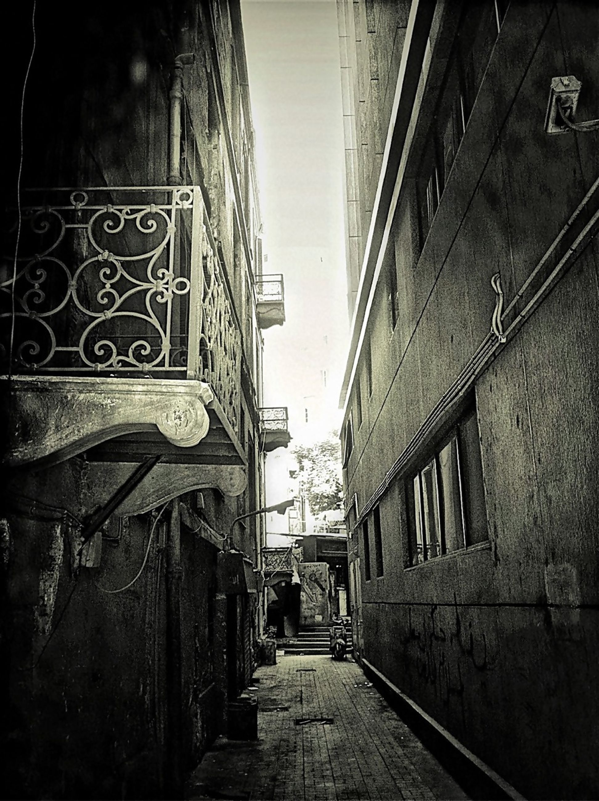 architecture, built structure, building exterior, the way forward, diminishing perspective, vanishing point, transportation, street, city, narrow, railroad track, alley, residential building, incidental people, residential structure, outdoors, building, day, long, walkway