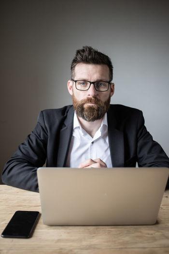 Mid adult man using laptop on table
